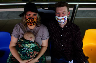 Sarah McKenzie and Matthew Bourke with their baby Finley Bourke in the gallery.